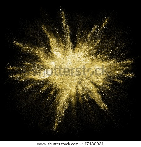 Gold powder particles explosion. Glitter burst with golden texture. Golden color dust splash for fashion background, luxury wallpaper. Magic mist glowing. Powdered vivid gold on black background.