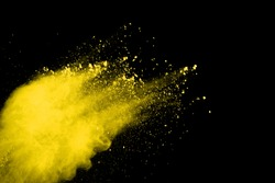 Gold powder particles explosion. Glitter burst with golden texture. Yellow color dust splash for fashion background.