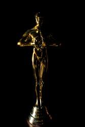 gold prize statue black background