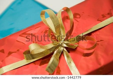 Gold Ribbon Bow on Shiny Red Gift Box