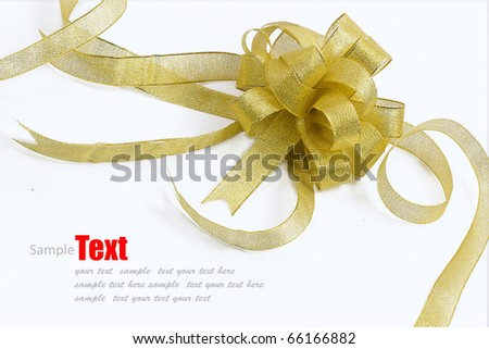 gold ribbon bow on white background with copy space