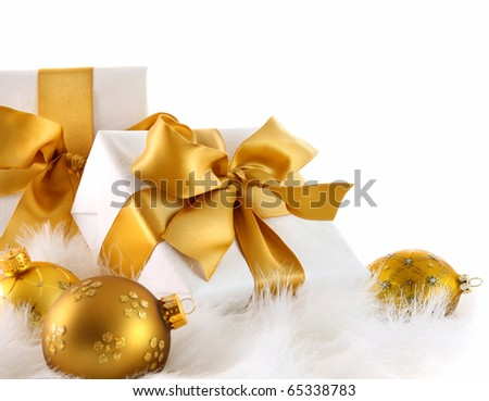 Gold ribbon gifts with christmas balls on white - stock photo