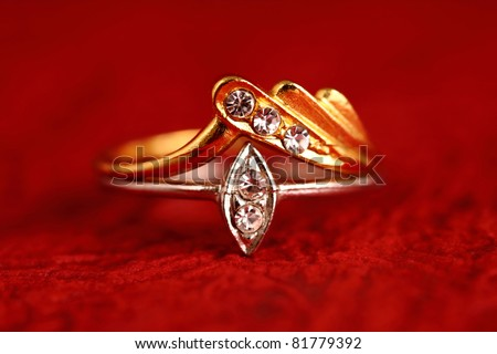 Gold ring on textured background