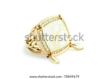 Gold ring with enamel and diamonds on white background.