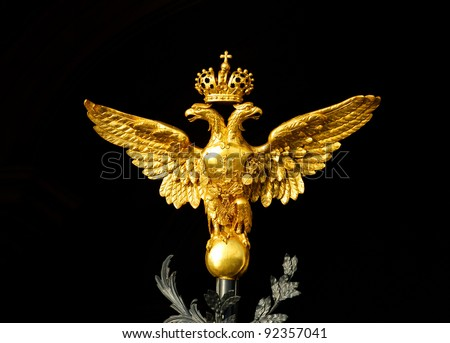 gold russian double-headed eagle on black background