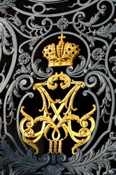 gold russian imperial family crown on Hermitage gates