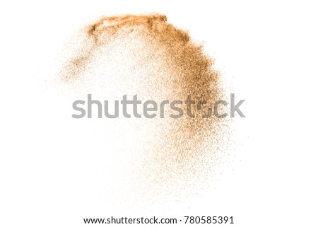 Gold sand explosion isolated on white background. Abstract sand cloud. Gold sand splash agianst on clear background. Sandy fly wave in the air. #780585391
