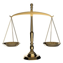 Gold scales of justice isolated on white background with clipping path.