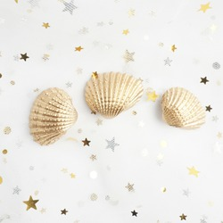 gold shell isolated on white background. golden shells. starfish, conch. star and moon yarn.