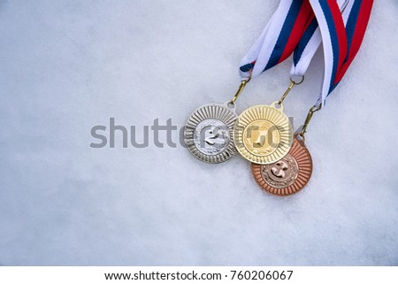 Gold silver and bronze medal, white snow background. Winter sport trophy for ski, hockey, nordic ski. Picture for winter olympic game in pyeongchang 2018