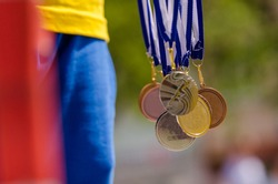 Gold, silver and bronze with symbol of running athlete. Nice wallpaper for summer olympic game in Rio