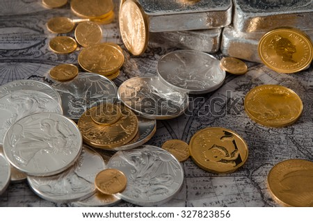 Gold & Silver Coins with Silver Bars on map #327823856