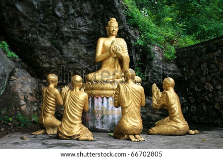 Gold sitting buddha surrounded by monk statues,Phou Si Hill, Luang Prabang, Laos, Asia