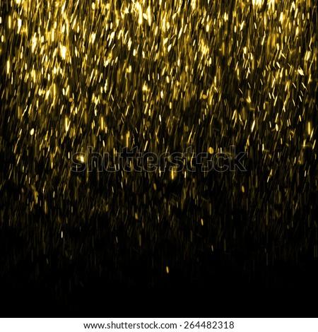 Gold sparkle glitter background. Fire rain background. Sparkling flow background