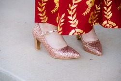 Gold sparkling shoes and red dress