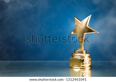 gold star trophy in smoke, blue background #1312461041