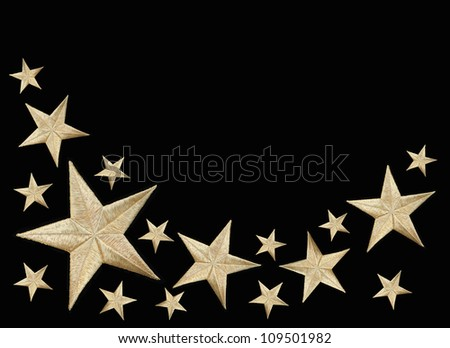 Gold Stars isolated on black background with room for your text