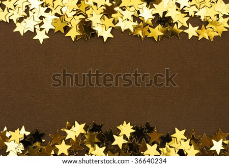 Gold stars making a border on a brown background, gold star border