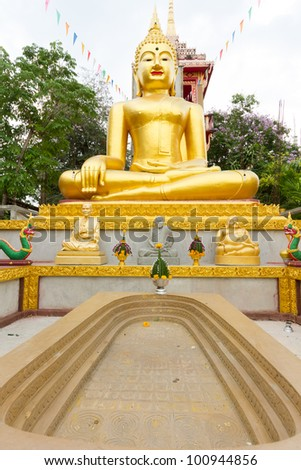 Gold Statue and Footprint Buddha #100944856
