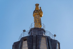 Gold Statue of Holy Mary on the top of Sanctuary of