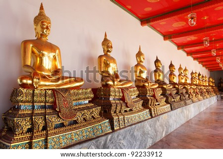 Gold statues of the Buddha abreast, Bangkok, Thailand