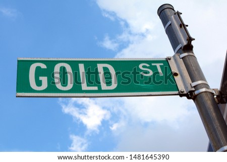 Gold Street Sign on Sign Post