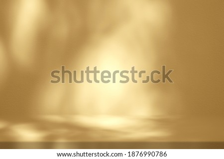 Gold Stucco Table with Nature Shadow on Concrete Wall Texture Background, Suitable for Cosmetic Product Presentation Backdrop, Display, and Mock up.