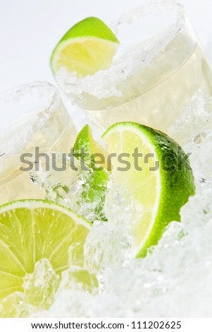 gold tequila with salt and lime on a ice.