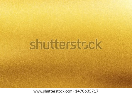 Gold texture background. Retro golden shiny wall surface.