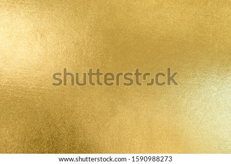 Gold texture background with yellow luxury shiny shine glitter sparkle of bright light reflection on golden surface, for celebration backdrop, wallpaper, Christmas decoration background or any design Stockfoto ©