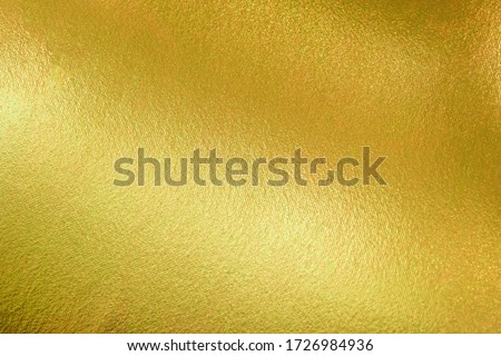 Photo of  Gold texture background with yellow luxury shiny shine glitter sparkle of bright light reflection on golden surface, for celebration backdrop, wallpaper, Christmas decoration background or any design