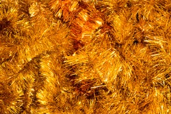 Gold tinsel Christmas decoration.