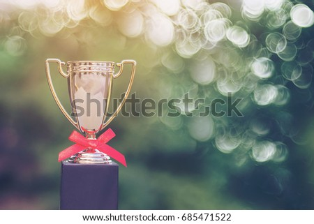 Gold trophy cup with blur background for the winner #685471522