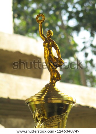 Gold Trophy Figurine for Awardees, Champions, and Winners #1246340749