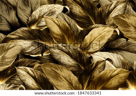 Gold tropical leaves patterned background ストックフォト ©