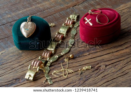 Gold valuables on a wooden table