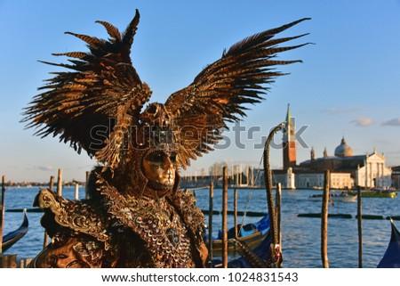Gold venetian carnival mask in st. Mark's square #1024831543