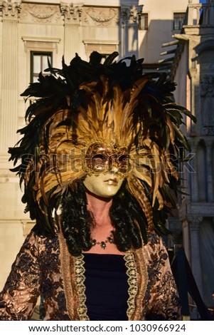 Gold venetian carnival mask in st. Mark's square #1030966924