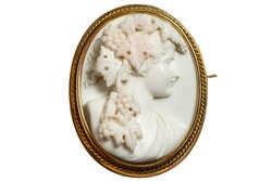 Gold vintage brooch with a woman's face in profile. White background
