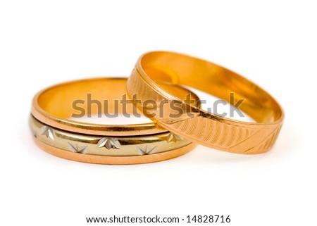 stock photo Gold wedding rings isolated on white background