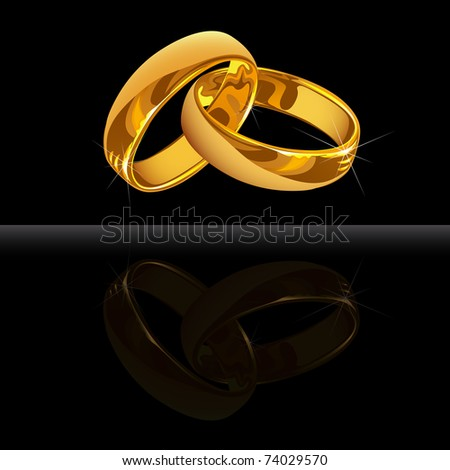 stock photo Gold wedding rings on black background with reflection
