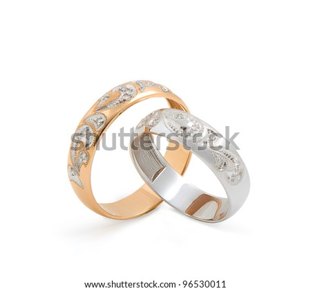 Gold wedding rings on white background with soft shadow. Isolated path included