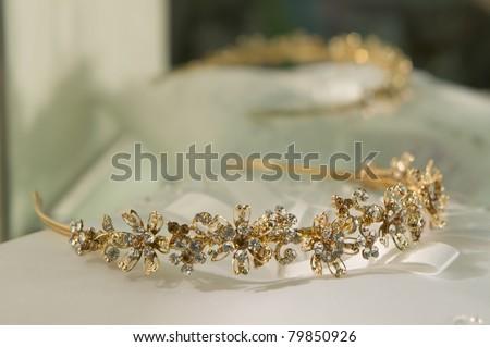 gold wedding tiara on a pillow