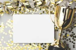 Gold winners trophy with a blank poster label and golden shiny stars