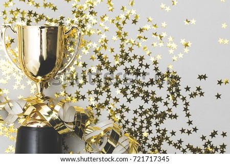Gold winners trophy with golden shiny stars #721717345