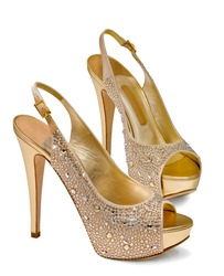 gold women's shoes isolated on white background