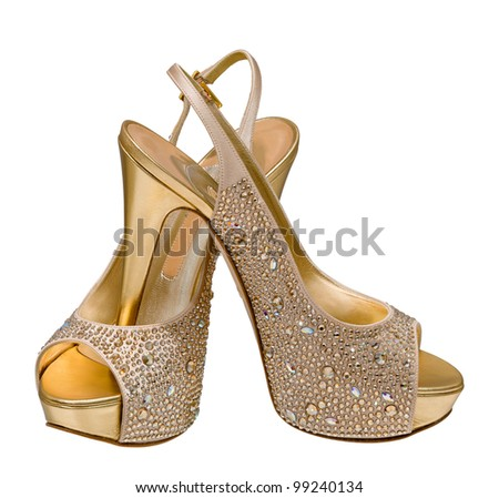 gold women s shoes isolated on white background
