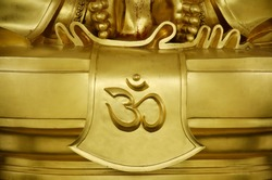 Gold word of hindu reading Om or Aum symbol in Devanagari is a sacred sound and a spiritual icon in Indian religions. It is also a mantra in Hinduism, Buddhism and Jainism.