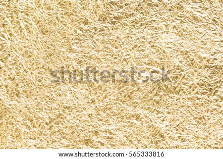 Gold wrinkled paper texture abstract background