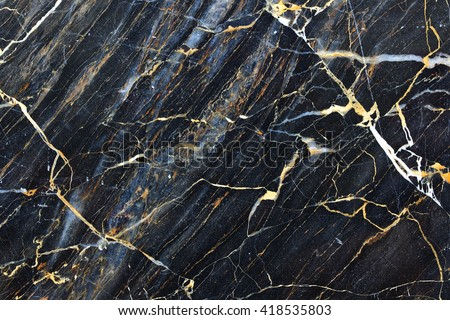 Gold yellow patterned natural of dark gray marble for texture and design #418535803